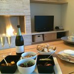 Tapas Hamper supplied by resort in front of fireplace
