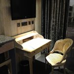 LED TV and writing desk in room