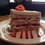 Strawberry cake.  Delicious. Big enough to share.
