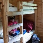 There are two bunk beds in the first bedroom, which is directly across from the sink in the kitc