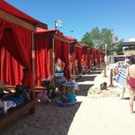 lovely cabanas surrounded by lovely sand.