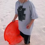 My son with the sledding disc.