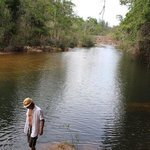 My husband wading in the Macal. The scenery is breathtaking here, and the entire experience is m