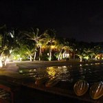 Ramon's Village at night lights up San Pedro's beach with energy and life.