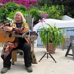 Dave Webb, a 'pollinator' (story teller) in full song at The Eden Project.
