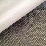 Stains all around beds on carpet