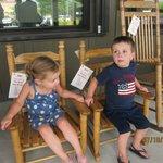 Kids sitting in the rockers outside