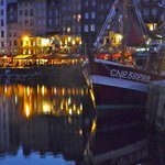 Fishing trawler and evening cafe's