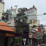 Hotel from the street, the little palmtree grows on the rooftop terrace