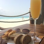 Mimosas with a view from the premier lounge. Courtesy of the best server Ricardo.