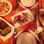 Grilled squid, fish, vegetables, fried potatoes