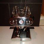 The great looking coffee maker in the room.