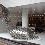 One of the windows - stylish shoe made of pots and lids