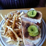 Clubhouse sandwich, fries and gravy. Uncle Tom's Restaurant     Hwy 16, Minnedosa, Manitoba R0J