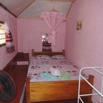 """The """"Pink Room"""" comes with an extra long bed (7 feet) for tall tourists."""