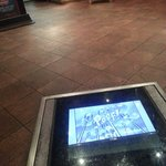 Video cartoons on the floor in waiting area.  What a great idea.