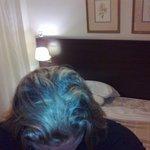 Minha cabeça e cama atrás