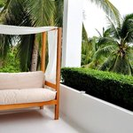 The balcony with a very comfortable daybed