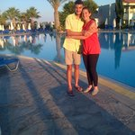 My 2 teenagers standing by the pool