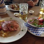 Great dinner of Bayrischer Leberkas, Cucumber Salad and beer