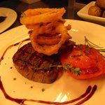 Local Fillet Steak with homemade crispy onion rings.