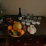 Fruit, water and wine welcoming gift.