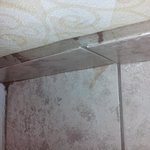 Sticky stain on tile floor of the bathroom.