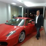 The owner with his Ferrari.