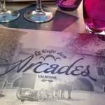 Outdoor seating at Cafe des Arcades