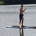 Liviu paddle boarding for the first time on Lake Huntington! !