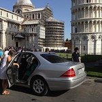 Near Leaning Tower of Pisa ! The lady in white-driver/guide. Son appreciated this as he was unwe