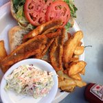 Perch sandwich with fries and coleslaw