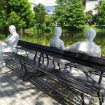 Three figures and 4 benches