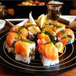 Our famous LANTERN ROLL - Softshell Crab/Mango Slices topped with Salmon & Tobiko.....oh boy!