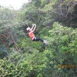 Having fun ziplining!