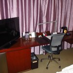 Work desk, chair, TV, and mini bar