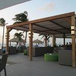 The bar area of the Bucuti & Tara Resort is adjacent...