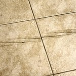 Sharp Crack across bathroom floor