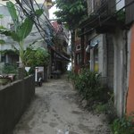 The alley you go down to get to the inn; the beach is in the background.