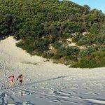climbing up sand dunes