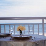 Dine alfresco on your private oceanfront balcony.