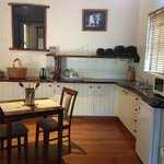 Very clean and spacious kitchen, cute dining table for two with roses