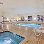 Relax on chairs and enjoy our indoor Swimming Pool