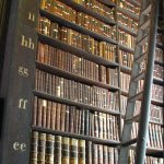 Library shelves full of historic books