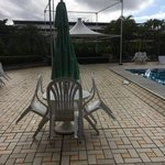 by the pool on a rainy cloudy morning