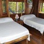 Bedroom with hammocks on verandah