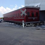Rail car in front of restaurant.