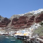 Amoudi Villlas is the white building in the lower left with red trim. The town of Oia is on the