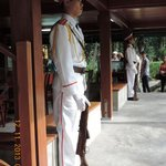 Ceremonial guards outside the rooms in Stilt house