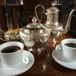 Siphon coffee served with vintage silver pots